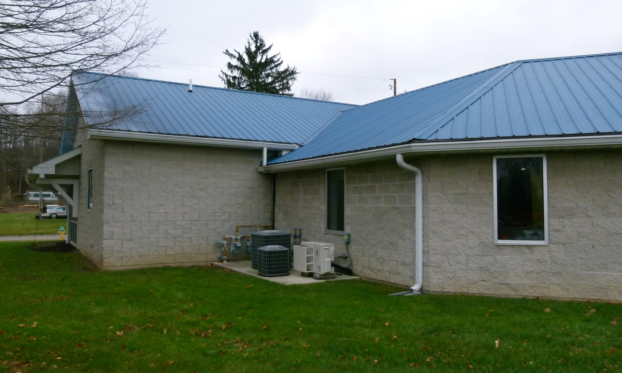 microscreen gutter guard installed on building with metal roof
