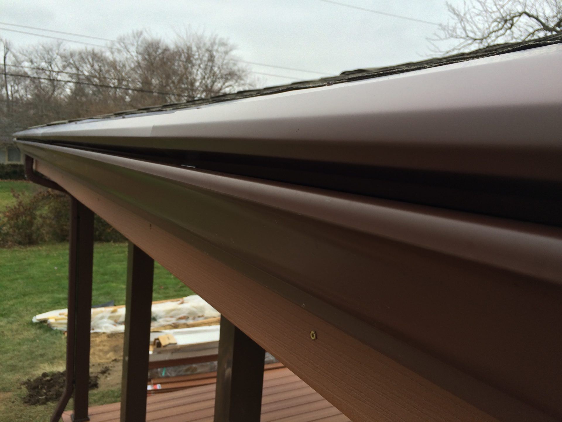 gutterlock gutter guard installed on 5 inch brown gutters in columbus ohio
