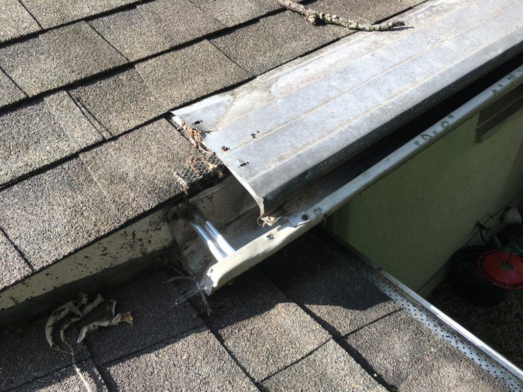 gutterhelmet with a missing end cap allows squirrels to enter and nest inside the gutters