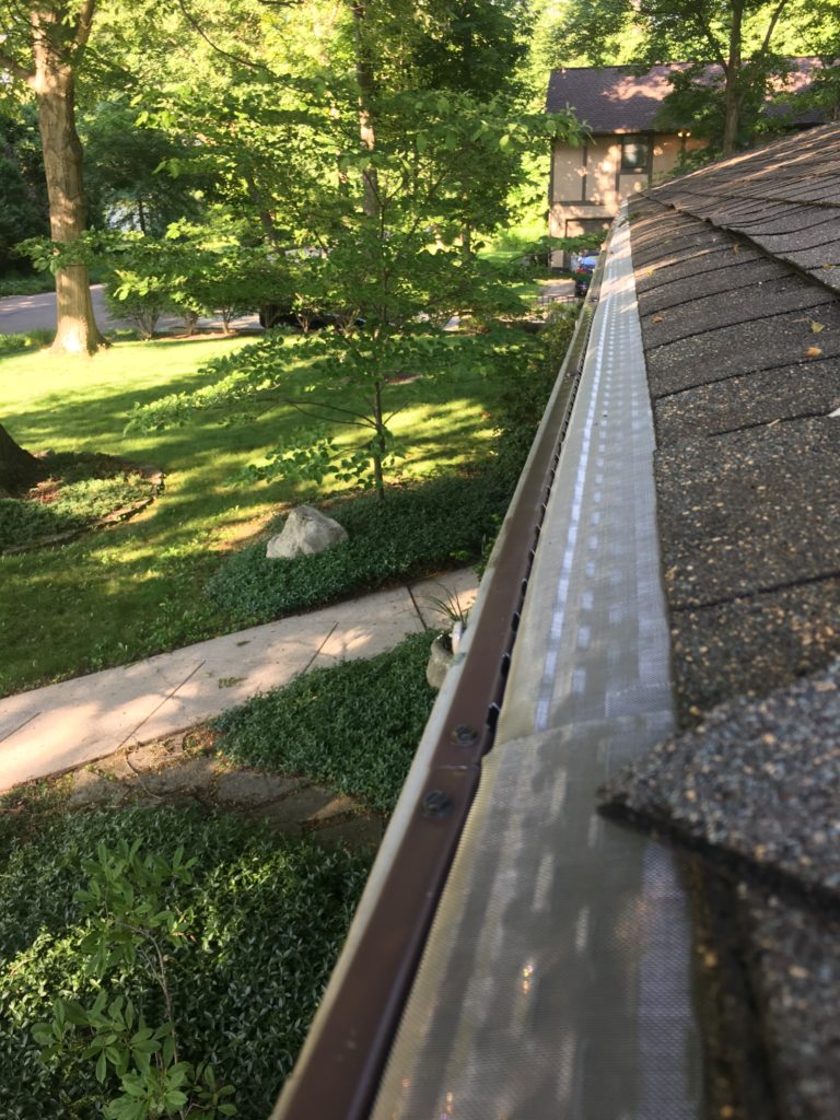 microscreen gutter guards installed on midcentury modern home in minerva park ohio.